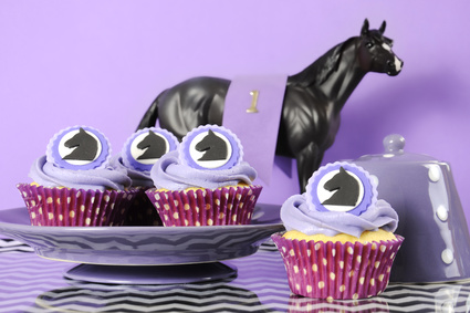 Black and white chevron with purple theme party luncheon table place setting for Melbourne Cup, Australian public holiday, horse race event cupcakes aginst purple background.
